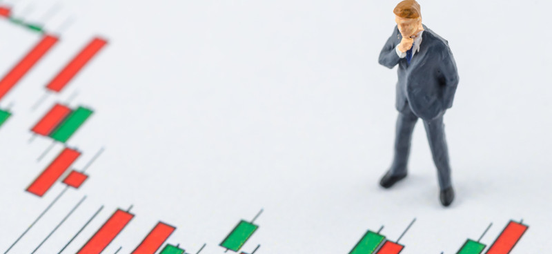 © Chillchilllanla | Dreamstime.com - Business Man Standing On The Candlestick Stock Chart Photo